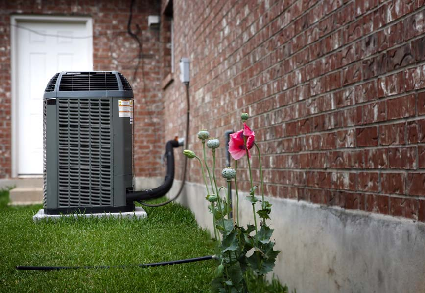 AC using R-22 refrigerant in backyard of home