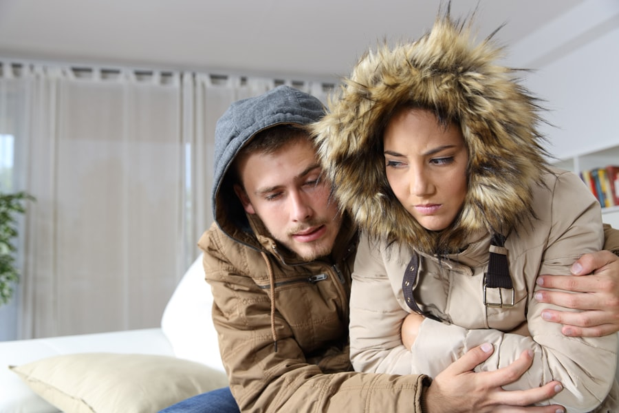 Couple trying to stay warm inside and keep the extreme cold outside.