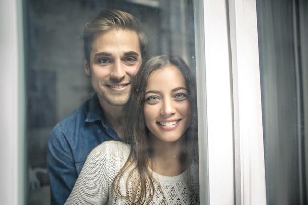 Furnace Pressure Switches, Cheerful couple looking out of the window